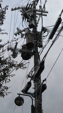 Complicated setup on Electricity pole in Japan with power line cables