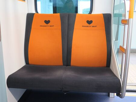 Bright orange priority seats on Japanese public transport in Tokyo
