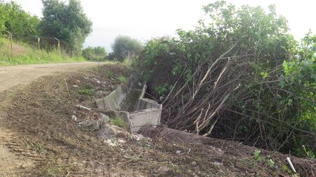 Excess shrubbery cleared along irrigation canal in Andalusian countryside Archivio Fotografico