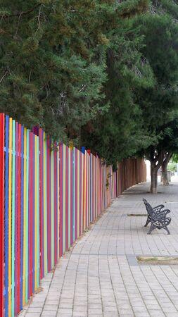 Multi colored fence outside Alora primary School, Andalusia
