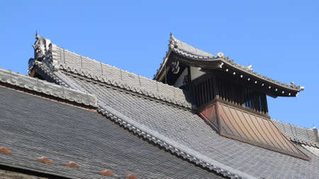 Kyoto, Japan - December 1, 2019: Temple roof detail in Kyoto park on clear sunny December day Editoriali