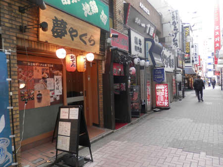 Tokyo, Japan - December 8, 2019: Small alley full of back street tiny bars in Golden Gai area during the day. Located in Kabukicho red light district, Shinjuku ward Editoriali