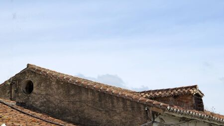Dormer windowed extention in need of repair in Andalusian village Archivio Fotografico