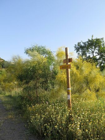 Rural signposts on verge near Alora, Andalusia, Spain pointing towards local walking trails