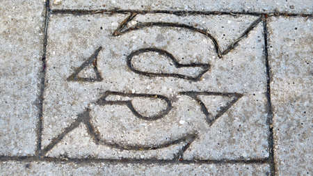 Alora, Spain - May 19, 2020; Spanish electricity company logo Sevillana on pavement slab Editoriali