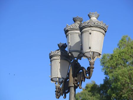 Closeup of Decorative Street Light against blue sky in Andlusian village
