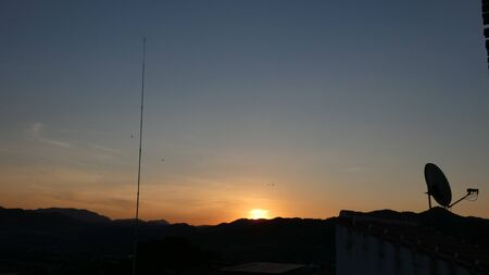 Beautiful golden spring sunrise over hilly Andalusian countryside