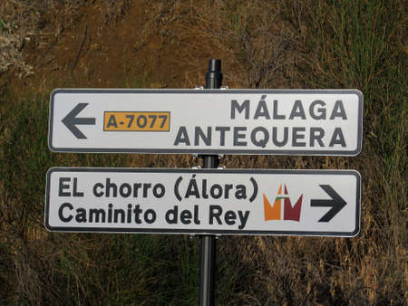 Rural signposts on outskirts of Andalusian village pointing towards Caminito del Rey, the King's Walkway and nearest large towns
