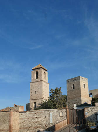 two square tower buildings at arabic castle in Andalusian village