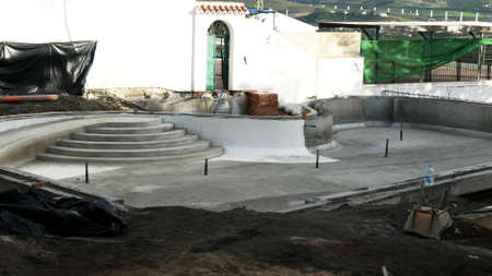 Concrete steps and dugout space for outdoor leisure pool Archivio Fotografico
