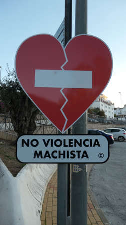 Red sign warning against violence against wemon around Valentines day