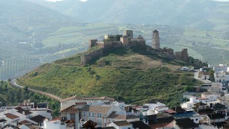 Arabic castle among white houses in village of Alora Andalusia Archivio Fotografico
