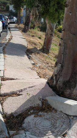 Broken Pavement Slabs on street in village in Andalusia