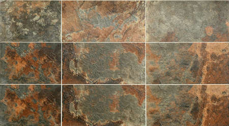 Selection of oxidized design on wall tiles in Andalusian village Archivio Fotografico