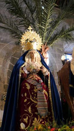 Alora, Spain - April 2, 2021: Religious figures on display in parish church on Good Friday Editoriali