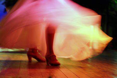 flamenco dress: the feet of a spanish flamenco dancer