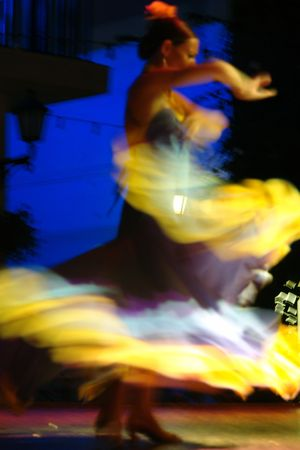 yellow dress: spanish flamenco dancer spinning round