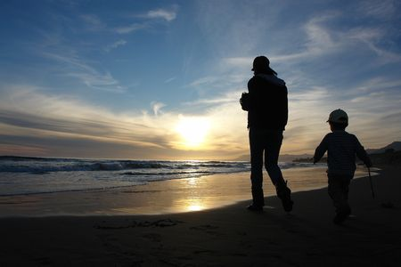 mother and child at sunset                               photo