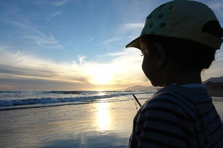 boy watching sun set                photo