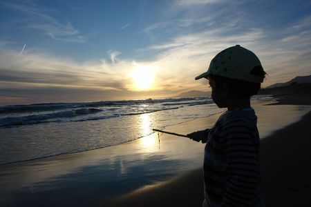 boy alone on a deserted beach                                photo