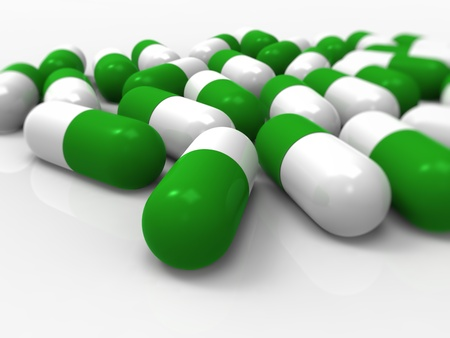 dosaggio: Medici capsule verde su sfondo bianco. Buon per il settore farmaceutico, medicale, salute e concetto di droga