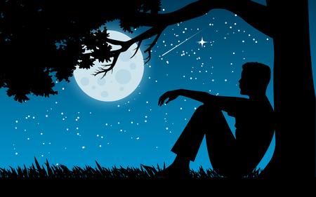 homme assis seul sous un arbre tout en regardant le ciel