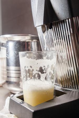 juice squeezer: glass of fresh juice in juicer squeezer
