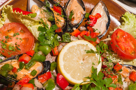 valencia orange: tradirional spanish cuisine paella with mussels and vegetables