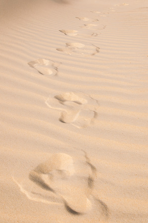 ways to go: Footprints of gone man left in sand