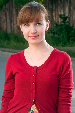 female clothing: Outdoor portrait of red head woman in red cardigan Stock Photo