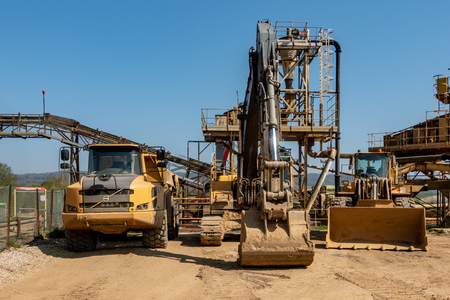 A Truck an Excavator and a Bulldozer on a quarry site