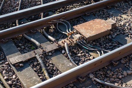 Railway impedance bond and bonding cables