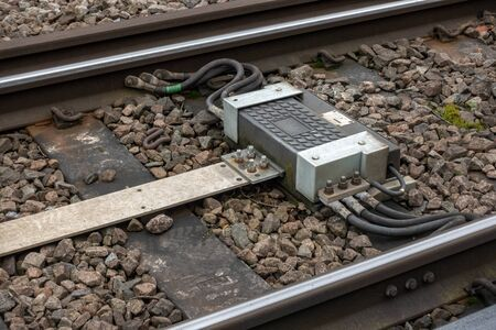 Railway Impedance bond provides a continuous path around insulated block joints for return current and to confine alternating signalling current to its own track circuit