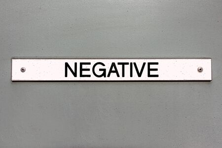 Negative sign on a grey panel background Stockfoto
