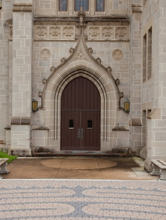 Block paved path and church door with stone arch surround Imagens
