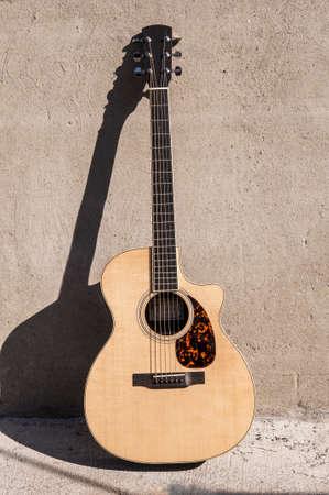 The front view of an acoustic guitar Banco de Imagens