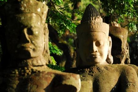 The faces of Buddhist statues in Angkor Thom  photo