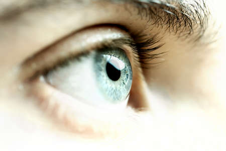 awe: Male eye looking forward.