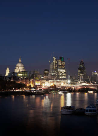lloyd's of london: City of London skyline at night. Stock Photo