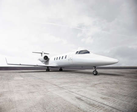 private plane: Private Jet on a runway. Stock Photo