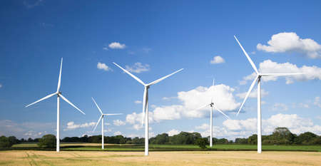 renewable resources: Modern wind tubines in a summer setting.