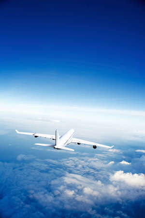 airplane engine: Modern Airplane flying in the sky. Stock Photo