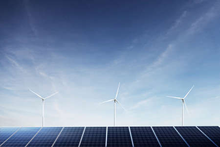 Solar Panels and wind turbines generating green energy. photo