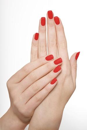 uñas pintadas: Red Nails Manicured Foto de archivo