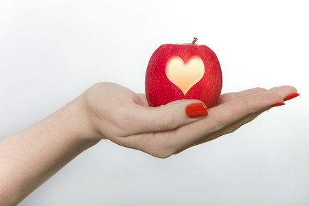 give out: Woman Holding Apple Carved with a Heart