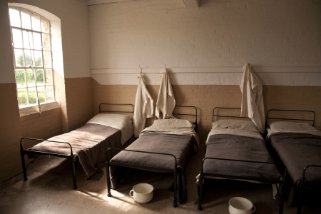 dingy: Row of Beds in a Workhouse Editorial