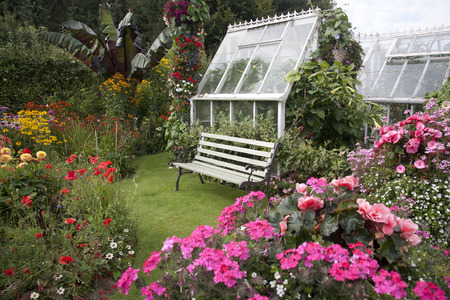 Cottage Garden Seat & Greenhouse photo