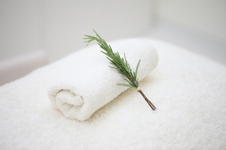Health Spa With Rosemary Resting on Towels 스톡 콘텐츠