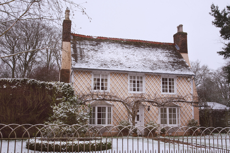 English Country Cottage in Winter Snow