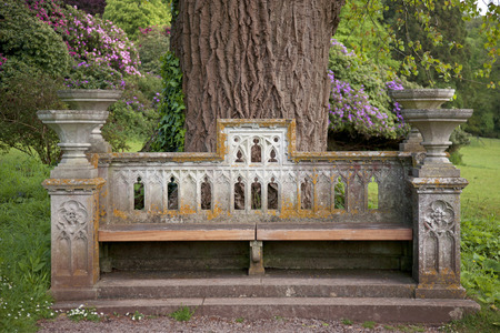 Ornate old stone seat in the grounds of a stately home Stock Photo